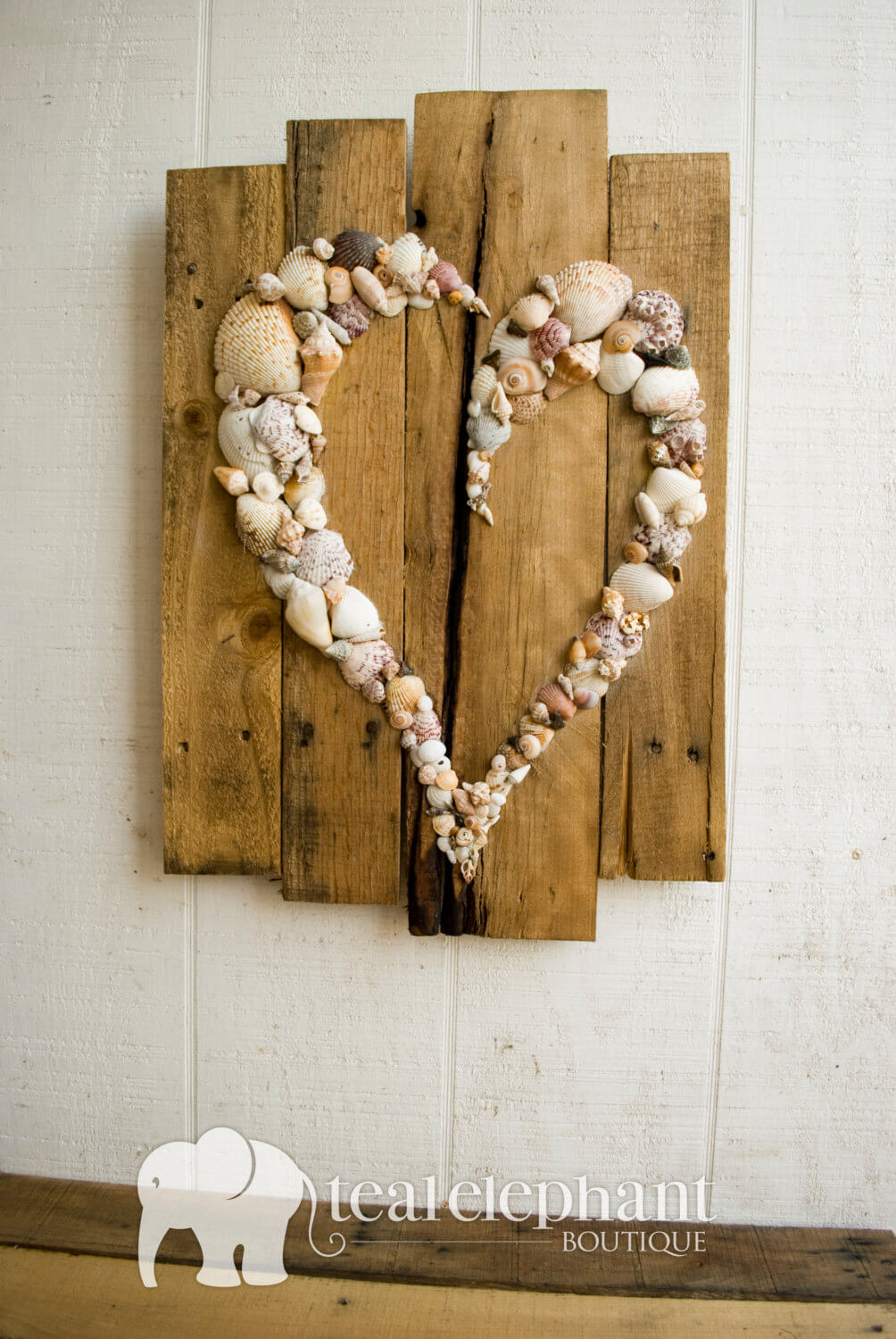 Heart-Shaped Shell Design on a Driftwood Background
