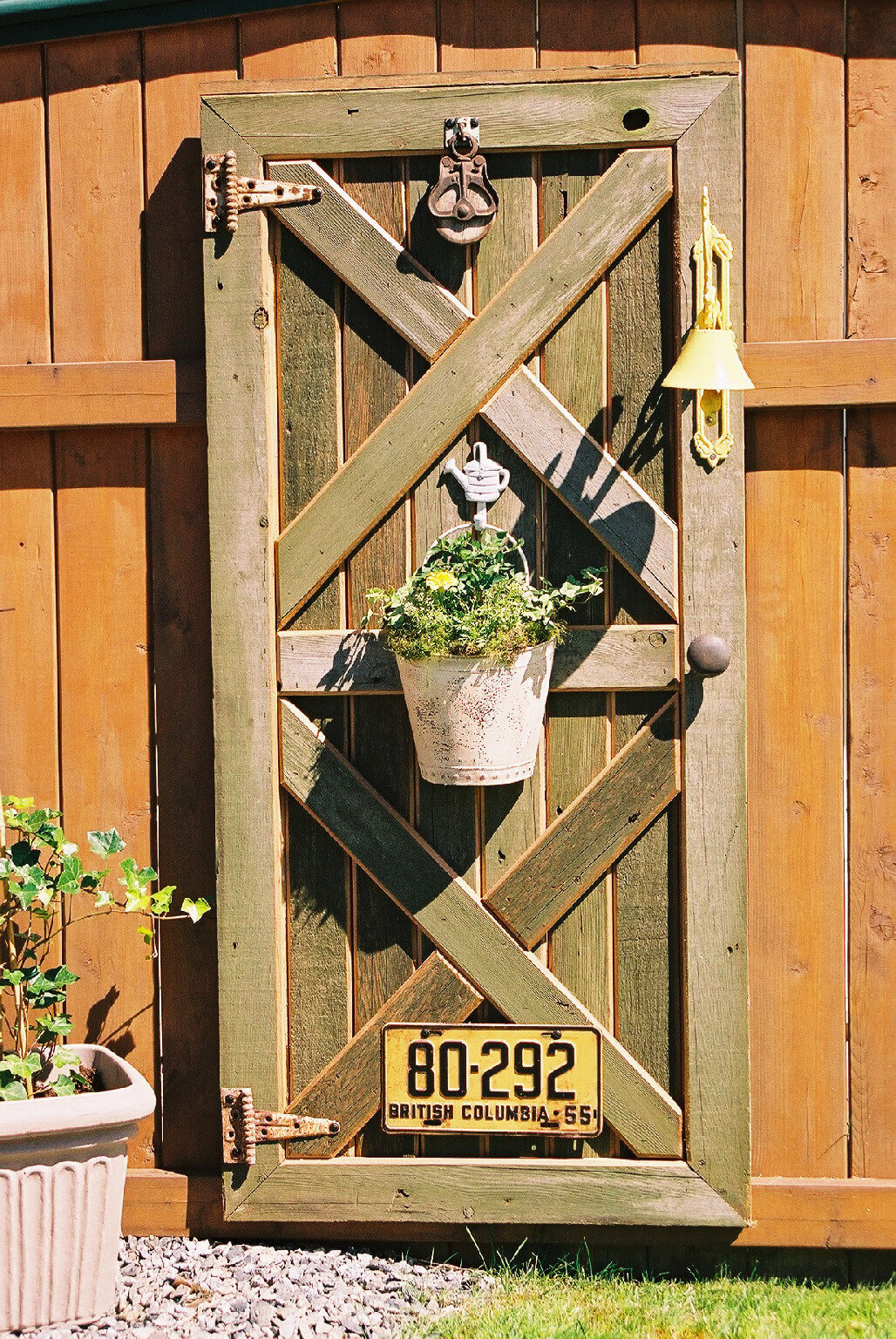 Hang an Old Door on the Fence