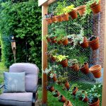 02-create-an-airy-garden-backdrop-with-simple-chicken-wire-vertical-gardens-homebnc