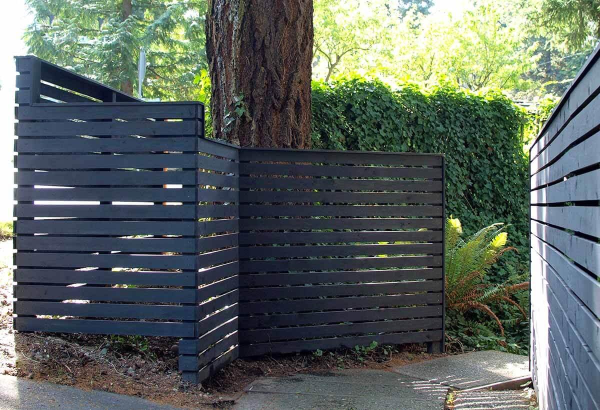 Darkly Painted Wooden Garden Fence