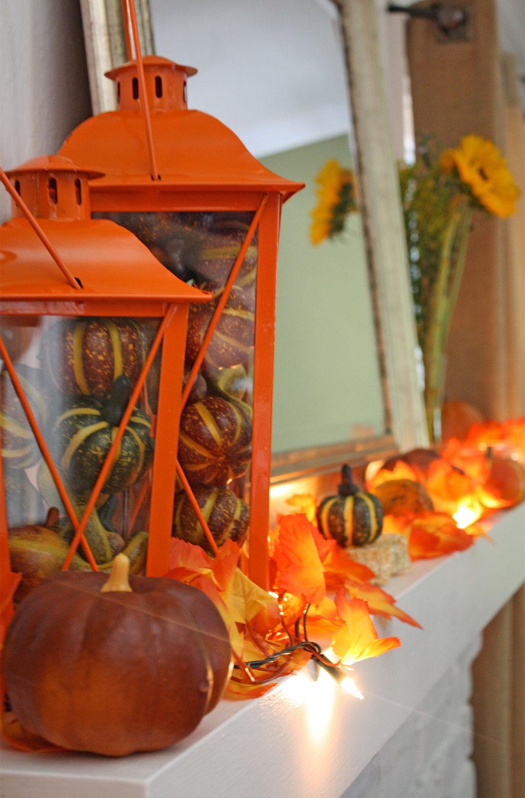 Orange Glow and Lanterns Light this Mantel