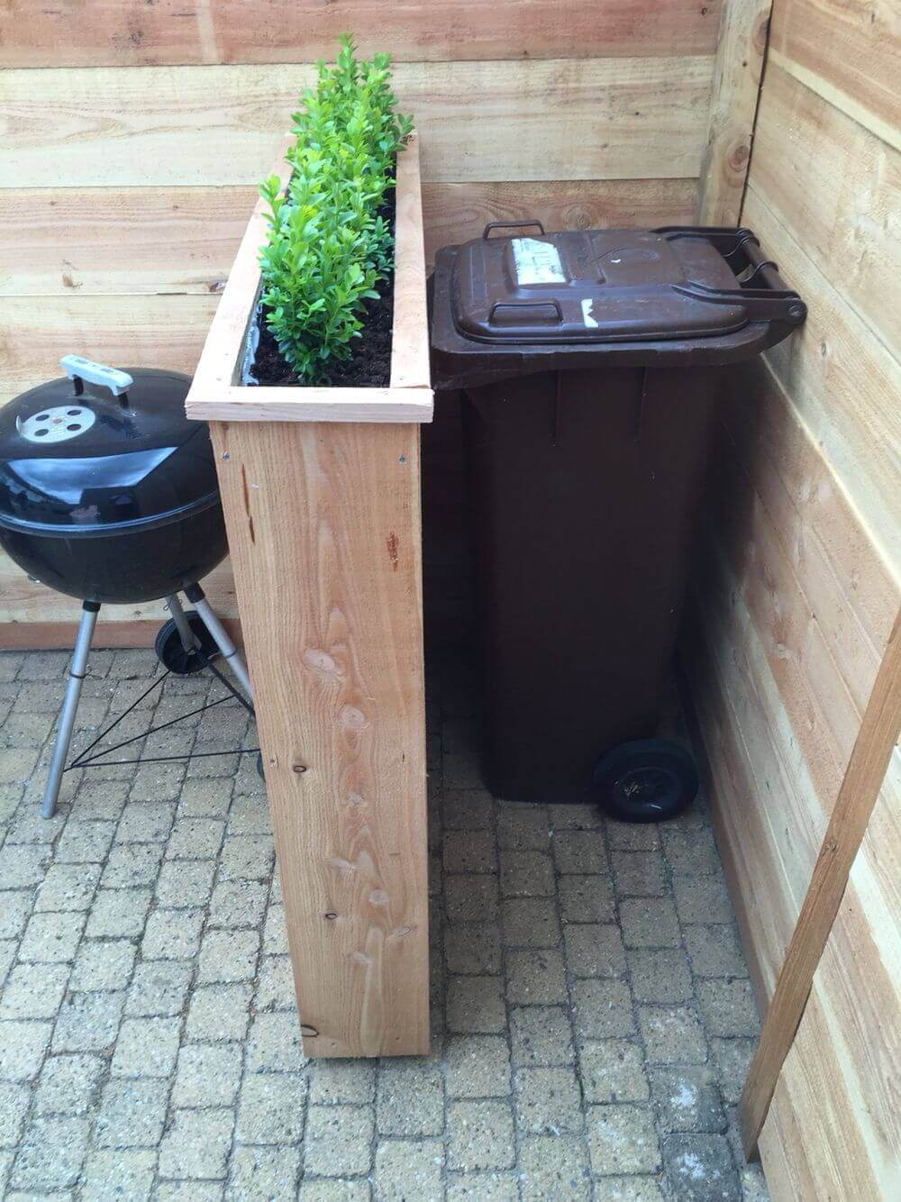 Lovely Raised Planters Hide Unsightly Bins