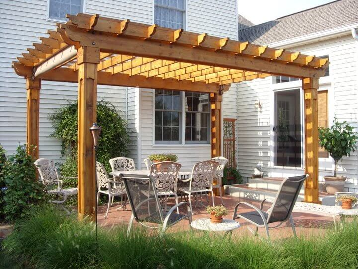 Lovely Arbor over Wrought Iron Furniture