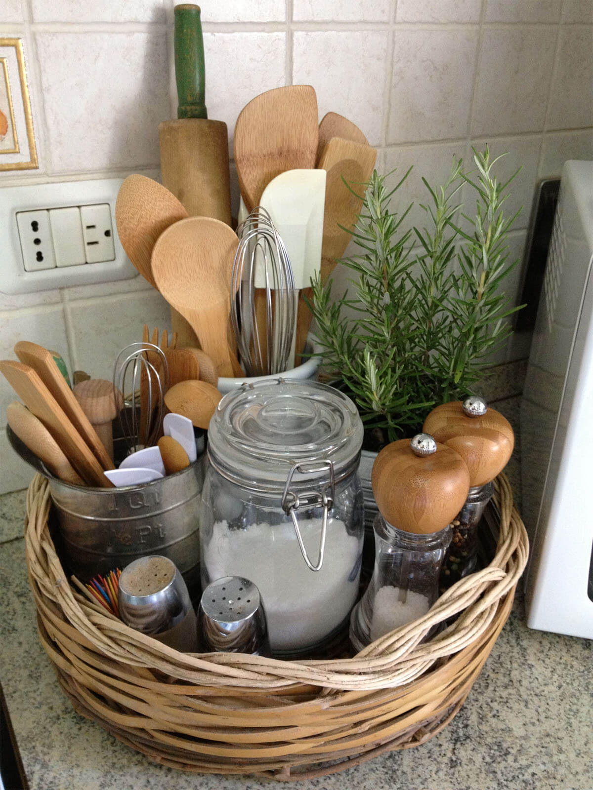 Basket Full of Herbs and Cooking Utensils