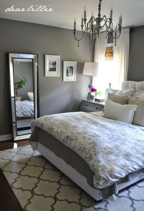 Charming Patterns and Fresh White Accents Adorn a Solid Grey Base Bedroom