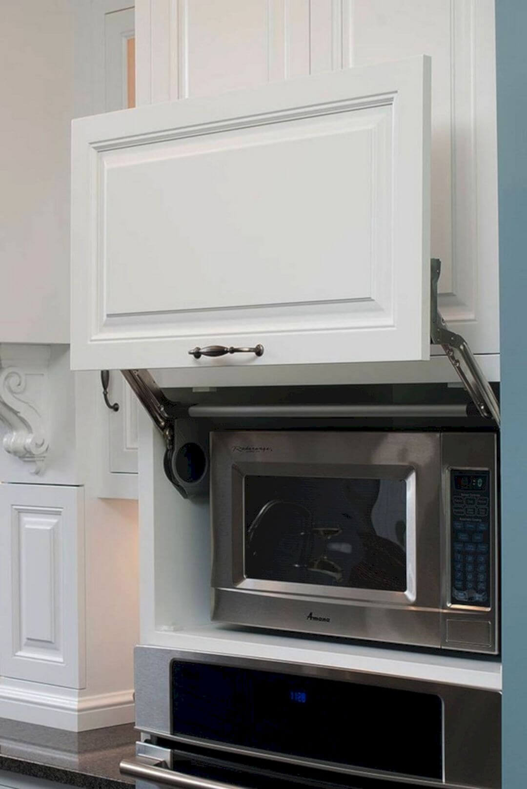 Handsome Hidden Faux Molding Microwave Cupboard