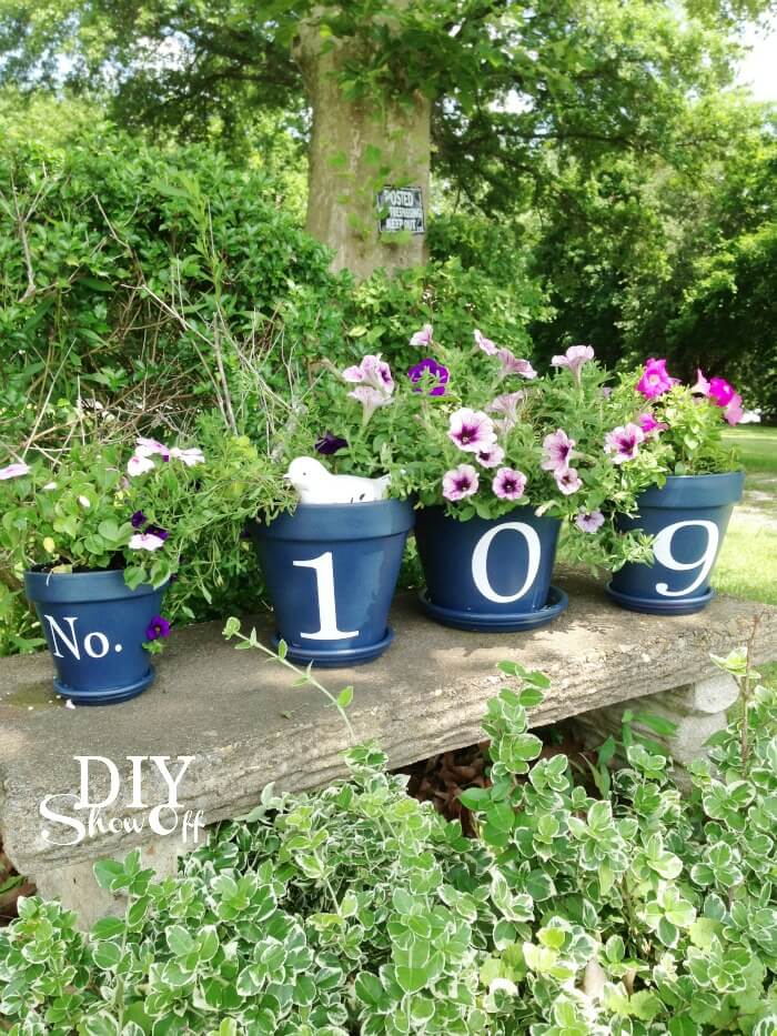 Lush Garden with Numbered Flower Pots