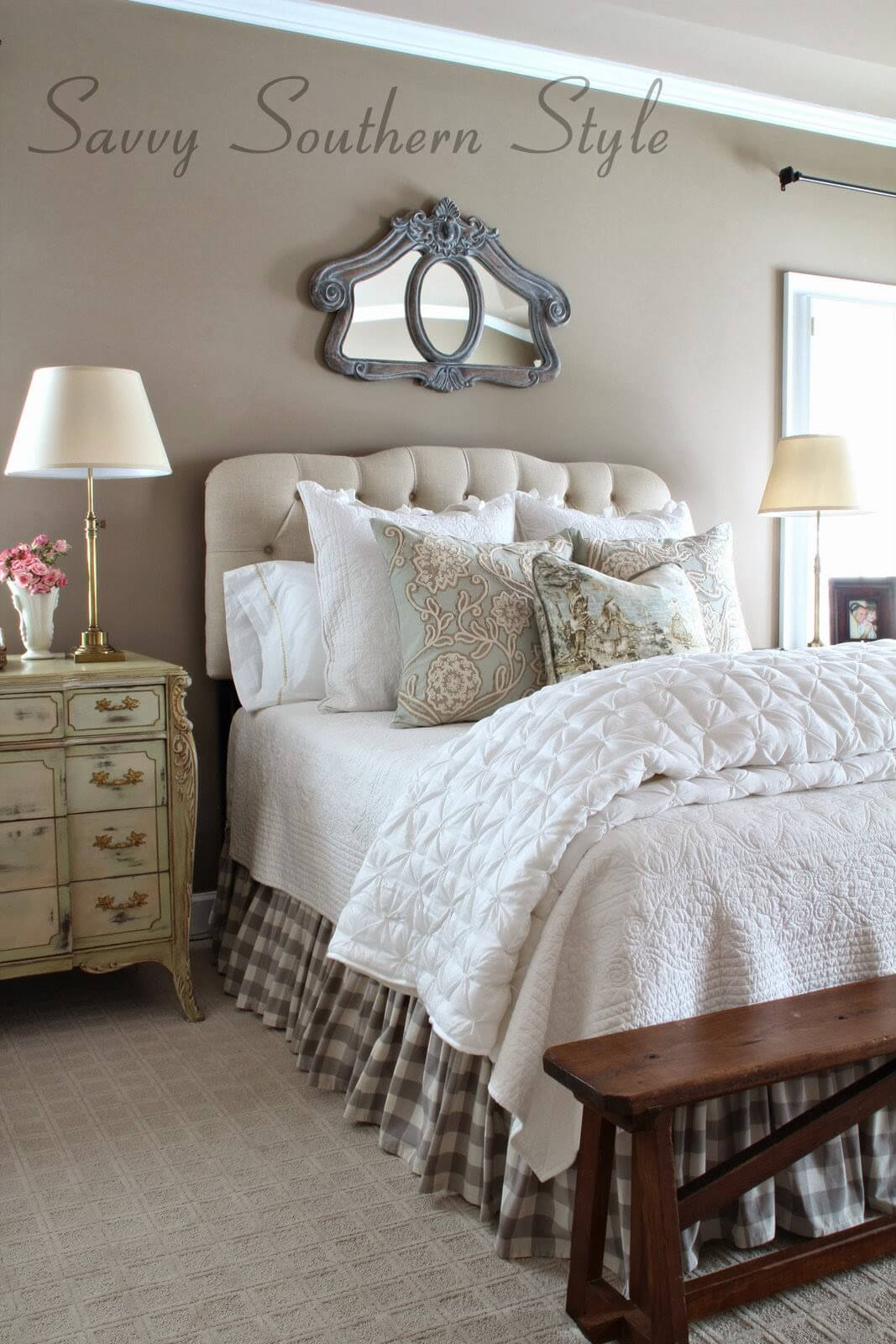 Tufted Headboard and Ornate Mirror