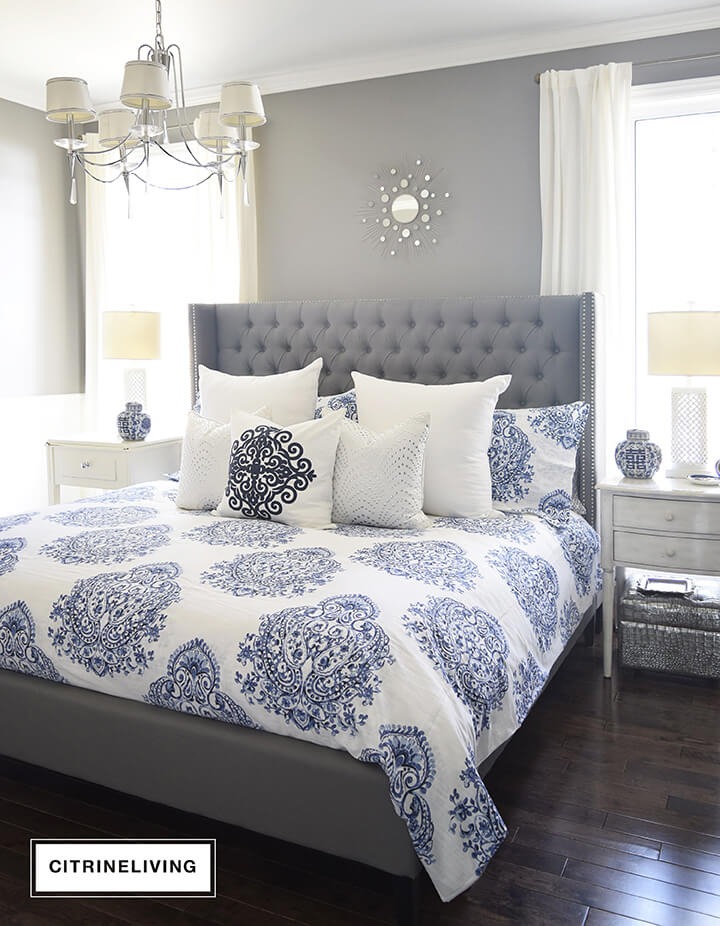 Bright, Cool Blue Patterns Add a Lush Touch to this Sleek Grey Bedframe