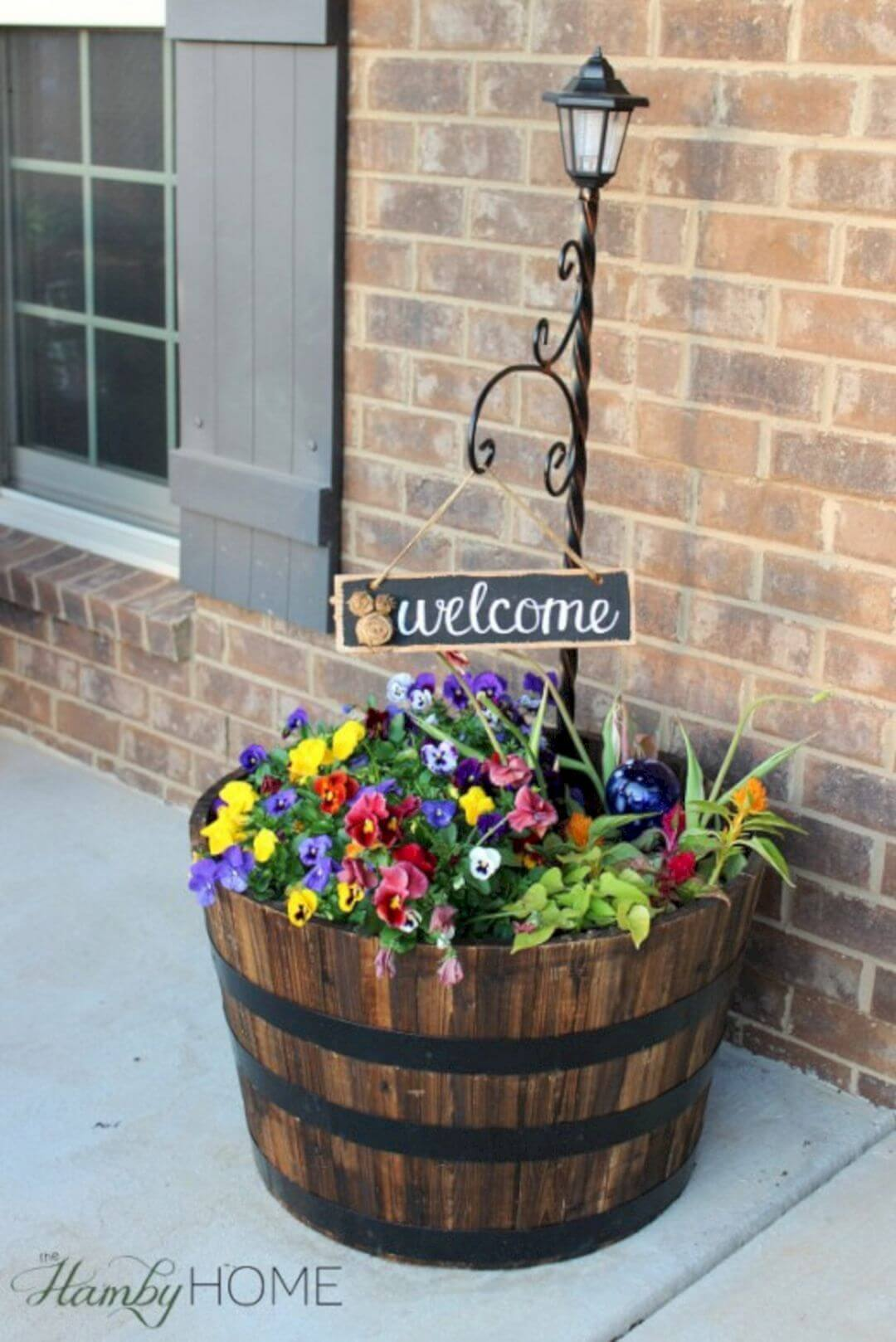 "Flower Barrel, Lamp Post and ""Welcome"" Sign"