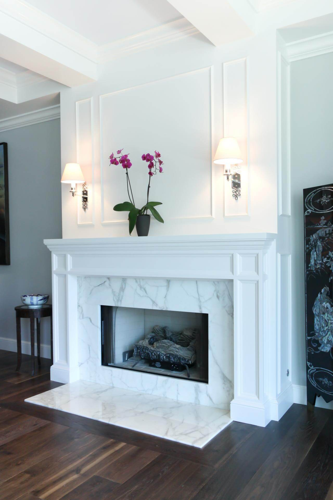 Classic White Paneling with Marble Surround