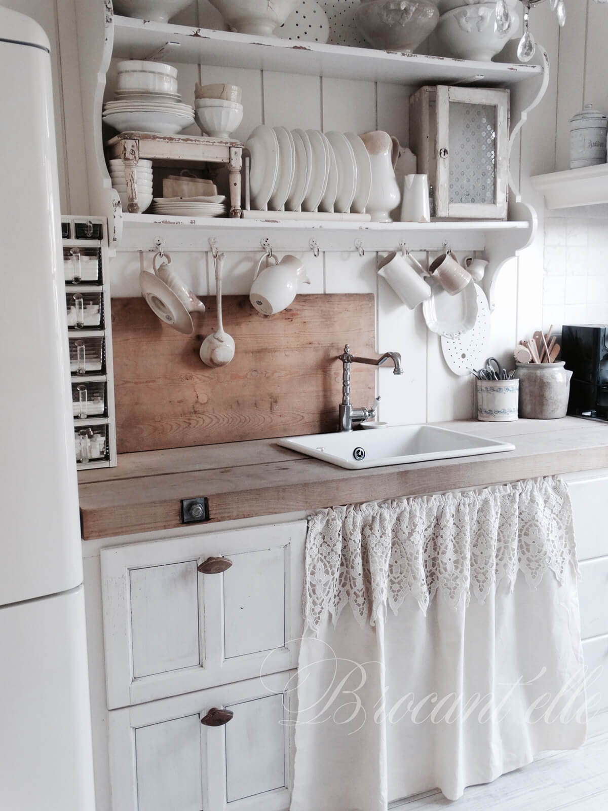 Lace Curtain Covering Shelves under the Sink