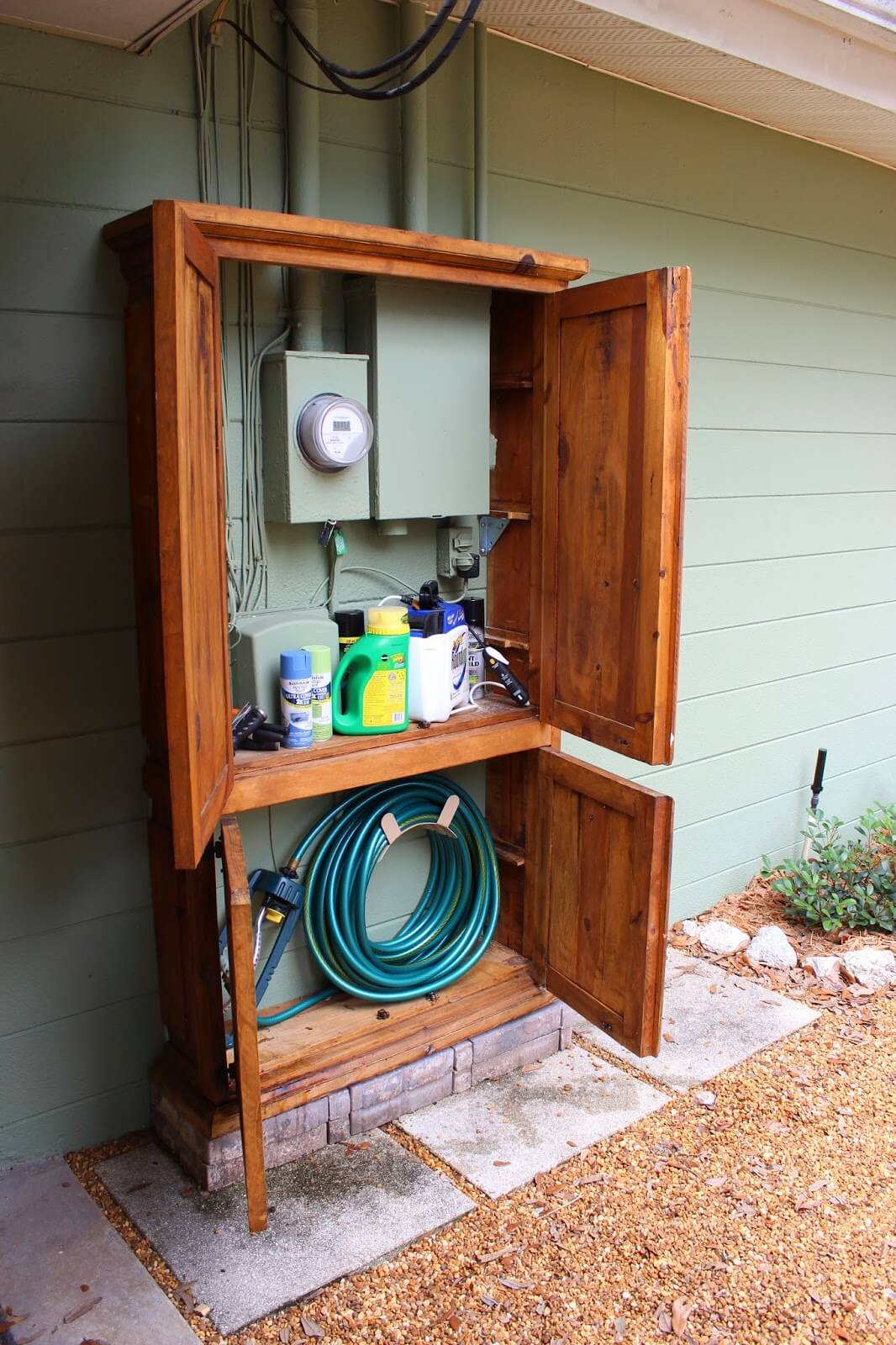 Lovely Cabinet Hides Utility Box and Garden Tools