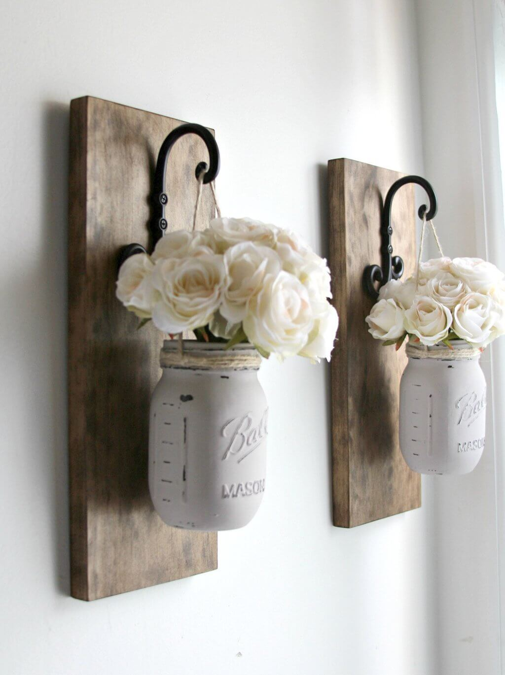 White Mason Jars Hung From Wall Hooks