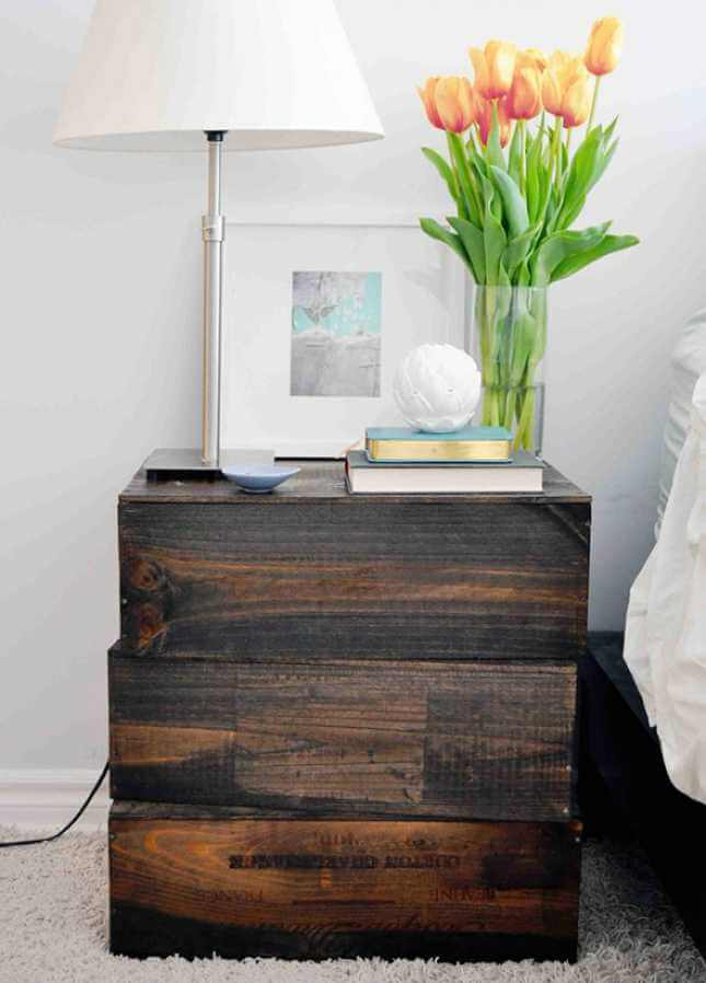 Stacked Stained Wooden Crates as a Bedside Table