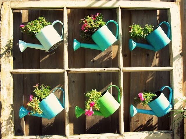 Whimsical Painted Watering Cans with Flowers