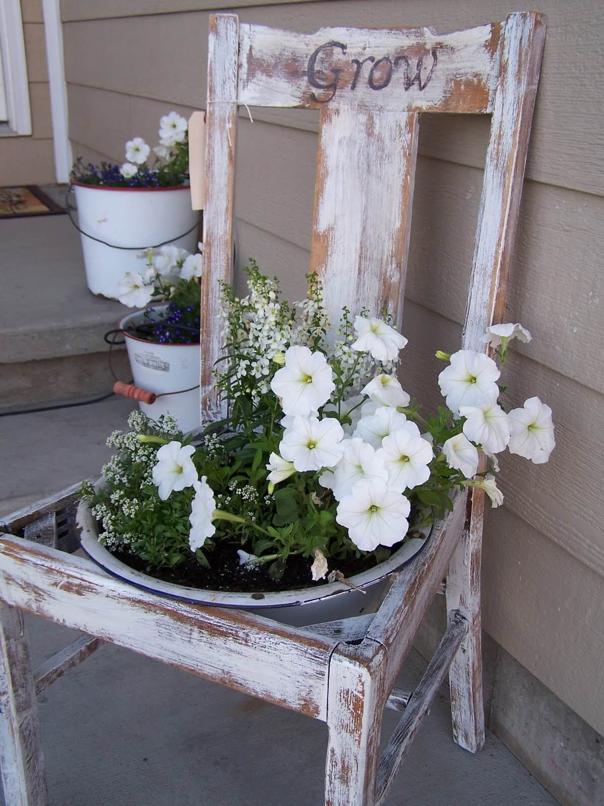 Distressed Wooden Chair With Potted Flower Arrangements