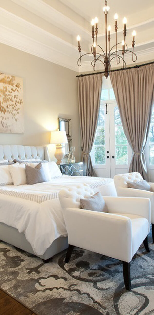 Grey Accents Ground this Sparkling White Bedroom Setting