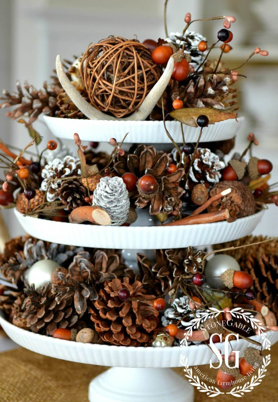 Rustic Tiered Display With Backyard Finds And Frosted Pinecones