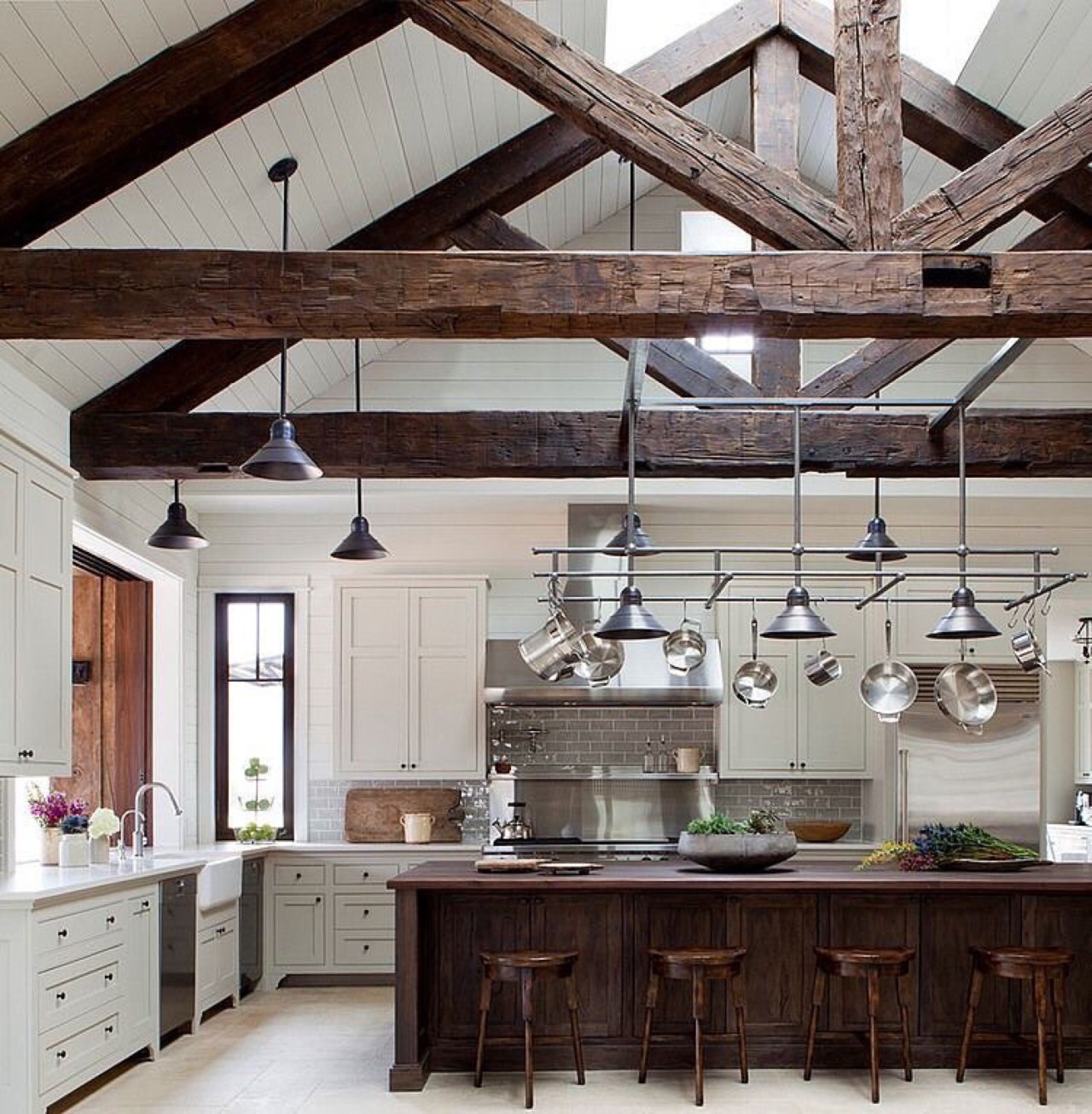 A Hefty Island Resonates with these Dominant Ceiling Trusses