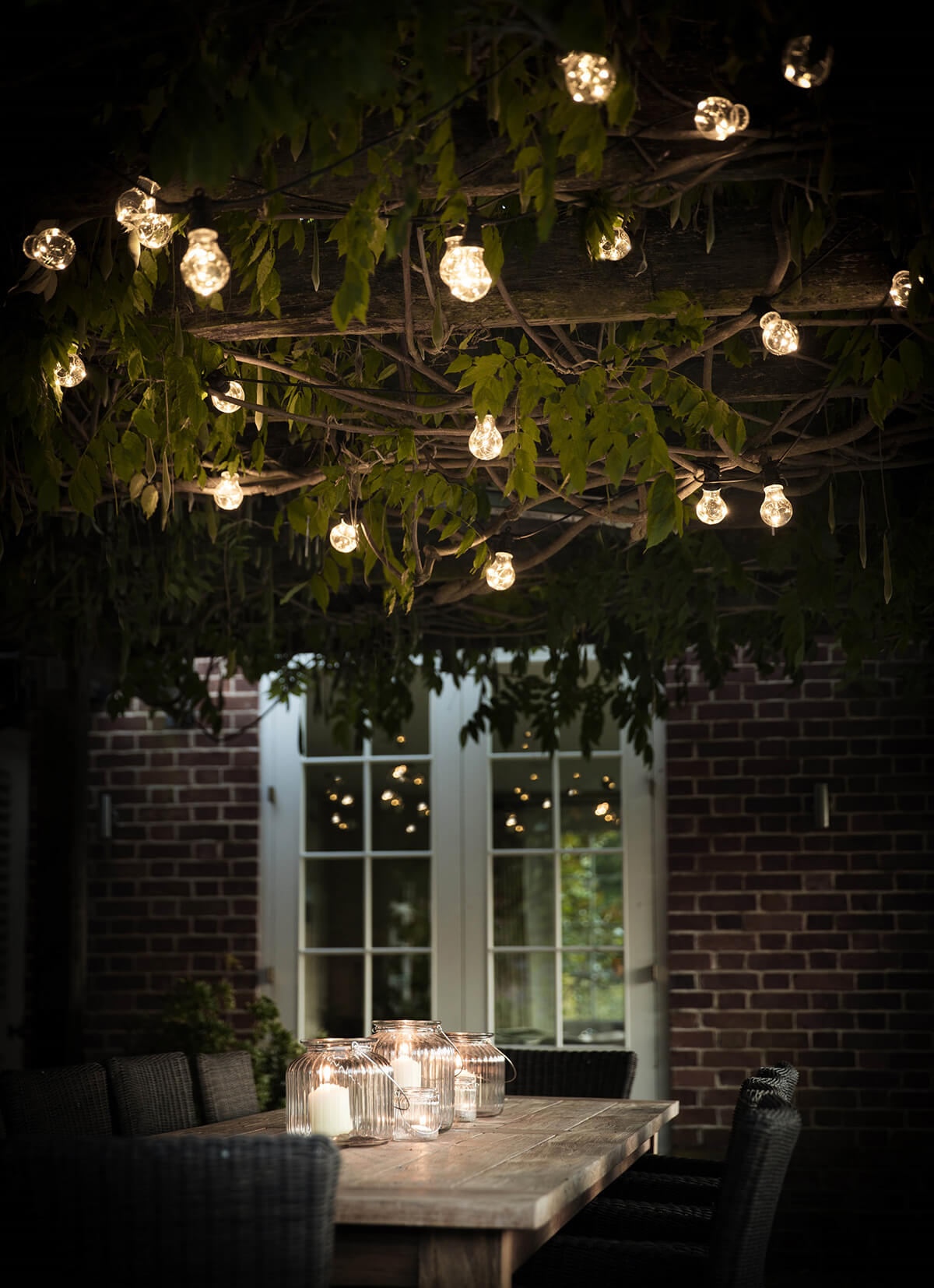 Exposed Globe Lights Over a Tabl