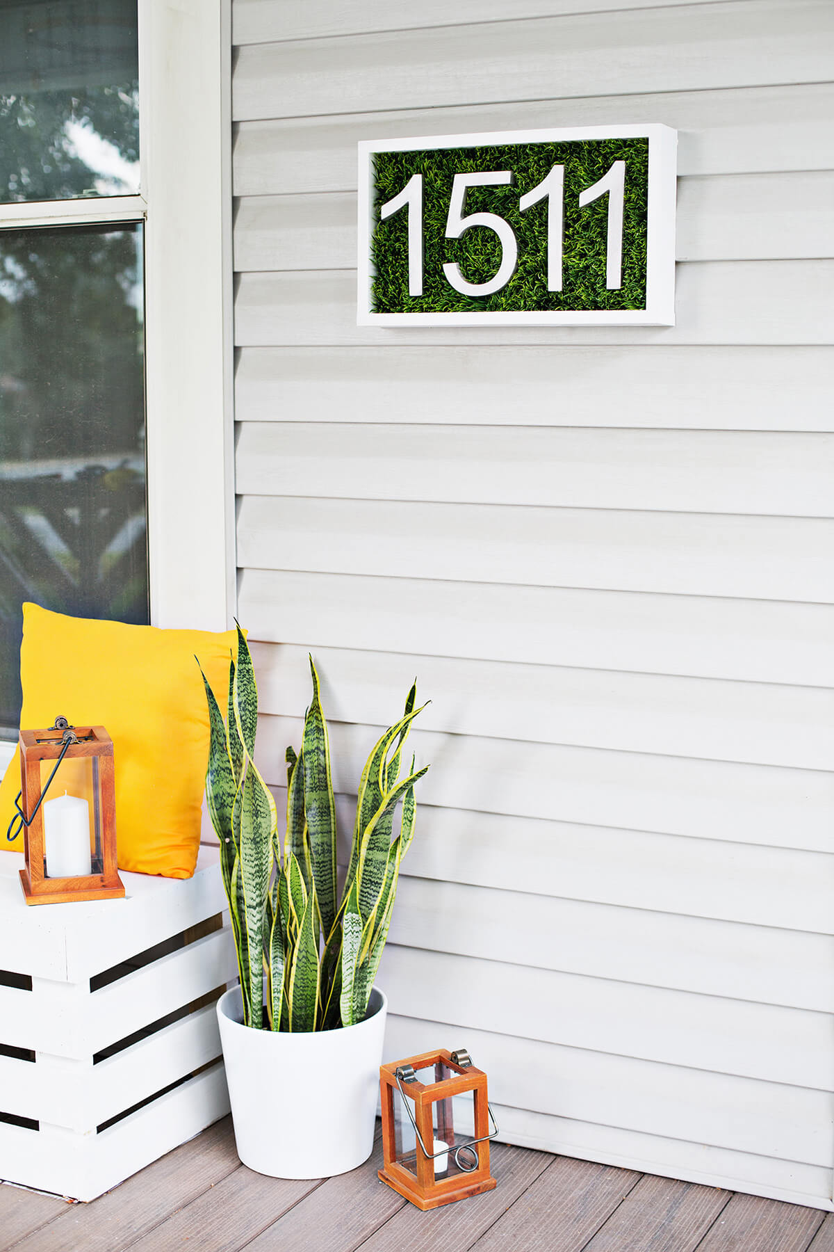A Patch of Grass on Off-White Siding