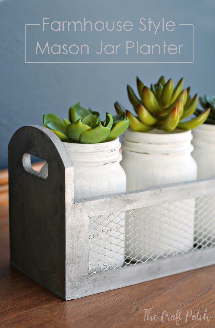 White Mason Jars in a Metal Container with Succulents