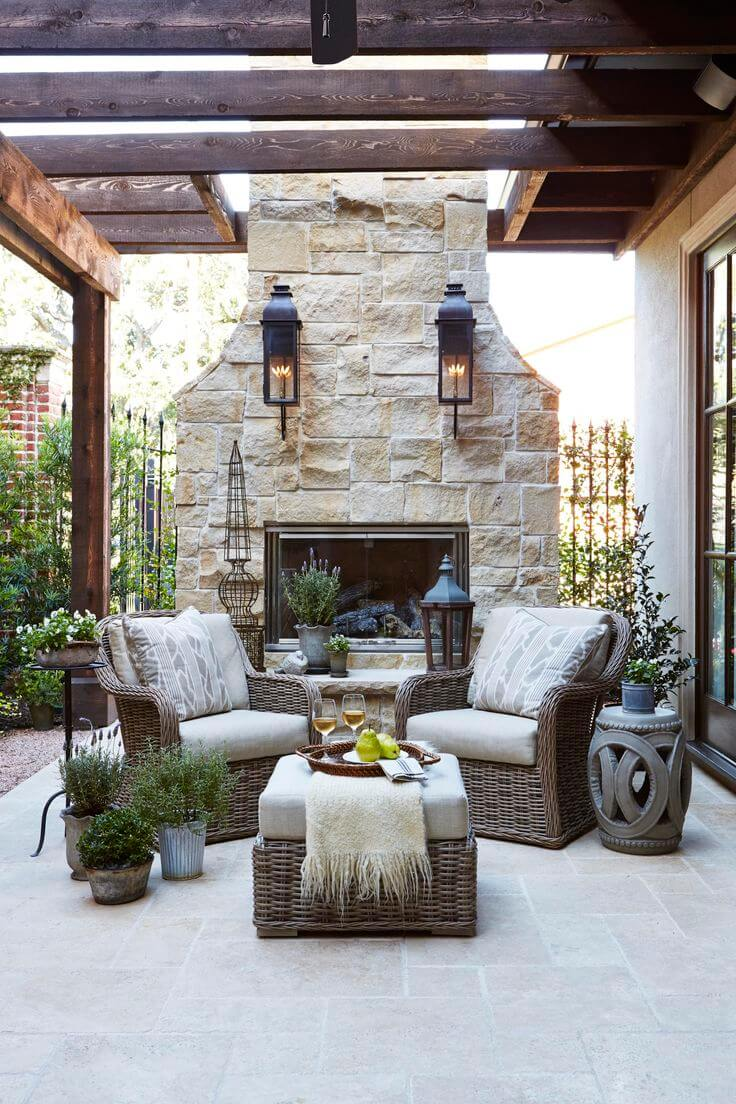 Sophisticated Wicker Arrangement by an Outdoor Fireplace