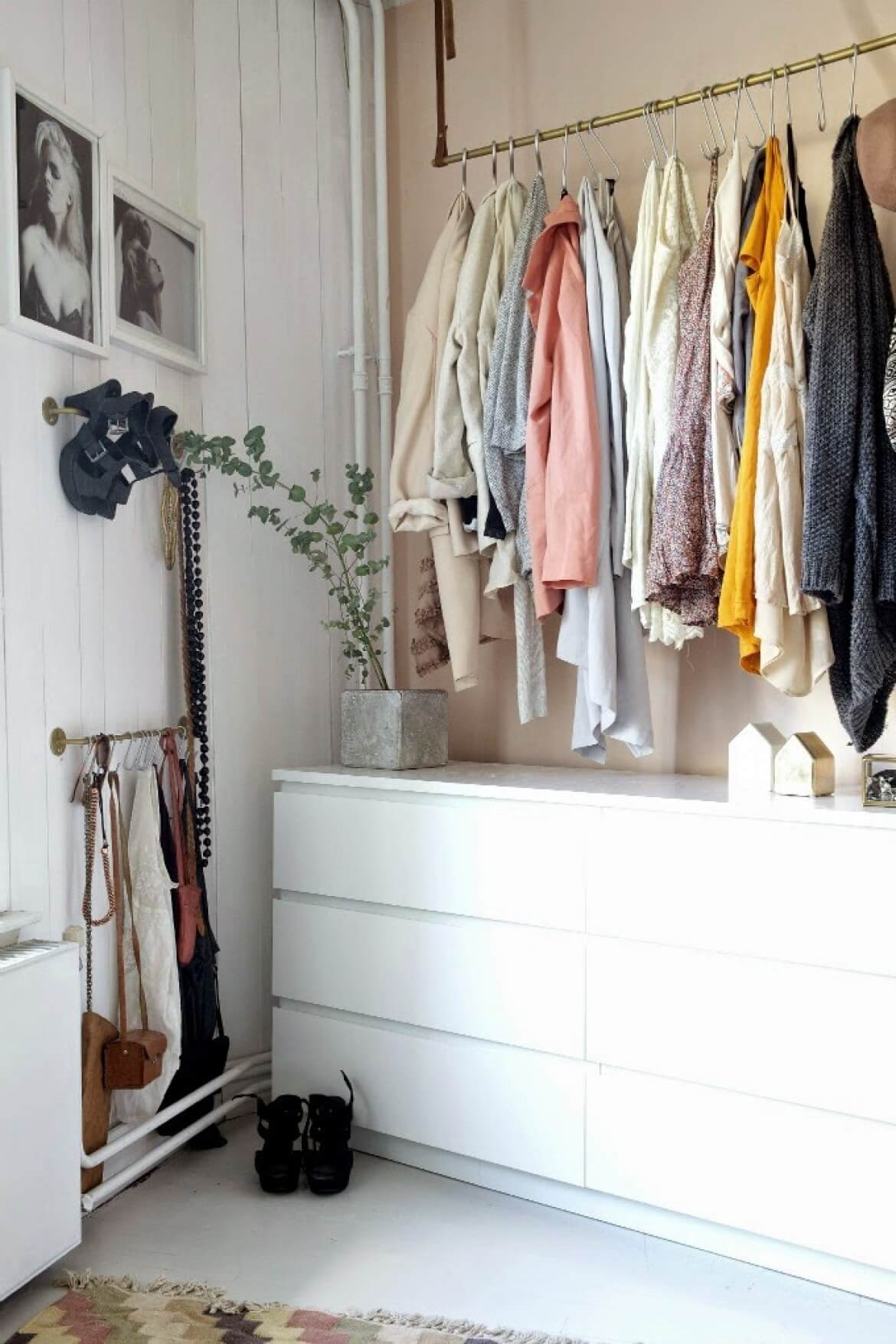 Gold Railing Above Dresser To Hang Clothing