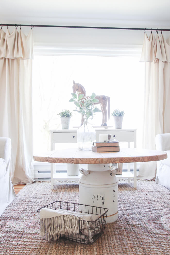 Wooden Table with Painted Milk Jug Base