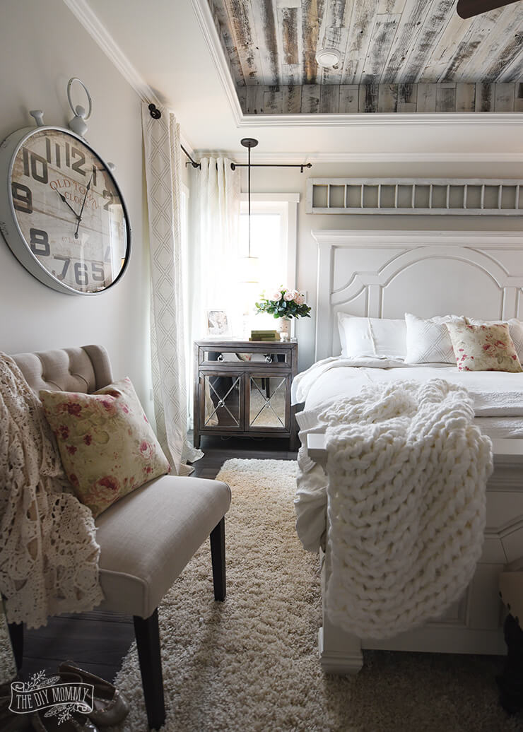 French Country Bedroom with an Oversized Clock