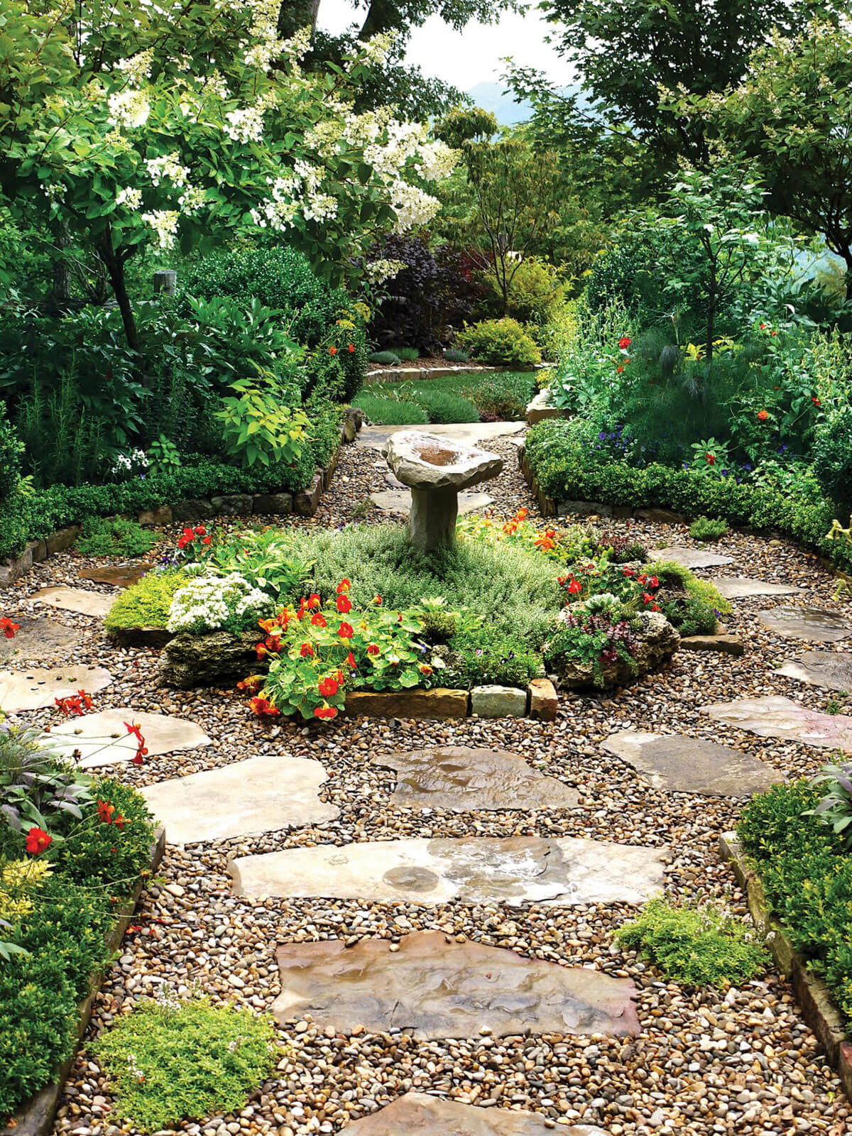 Romantic Stone Walkway Embraces A Garden Fountain
