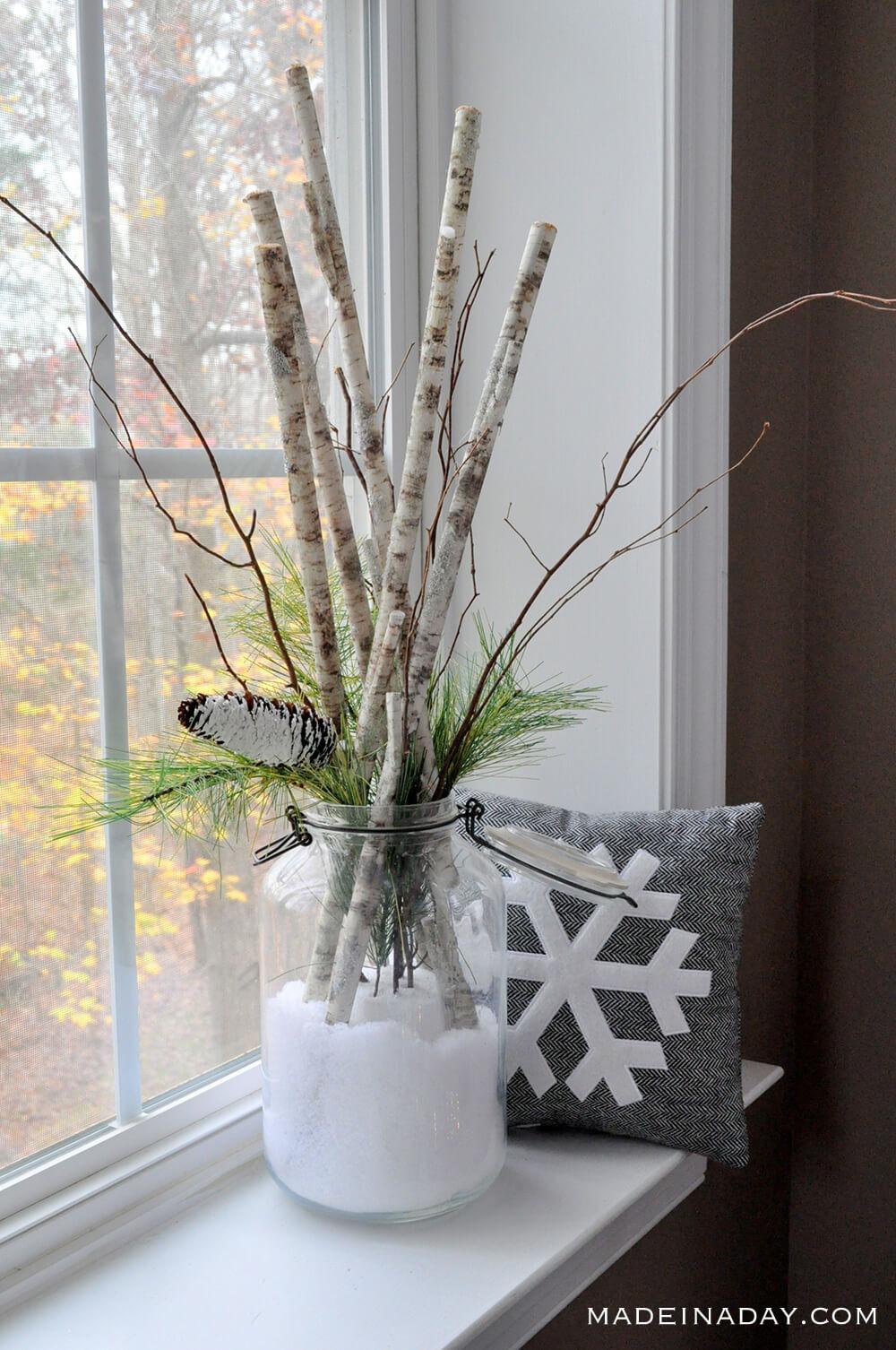 Unexpected Birch Sticks in Snow Arrangement