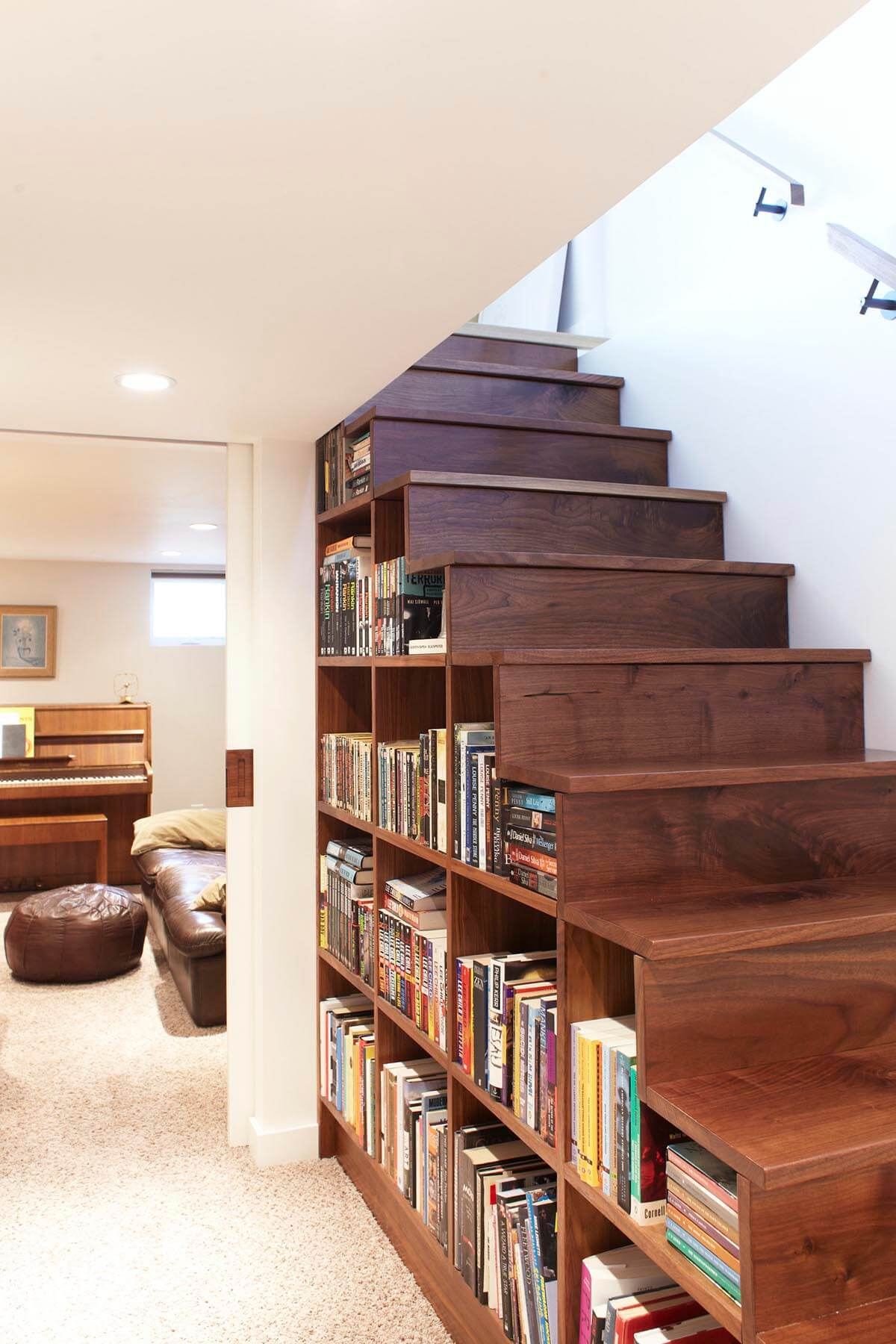 Custom Built-in Bookshelves Maximize Under-stair Space