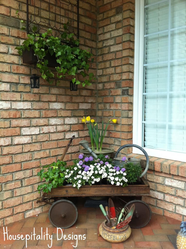 Antique Wagon, Watering Can and Potted Flowers