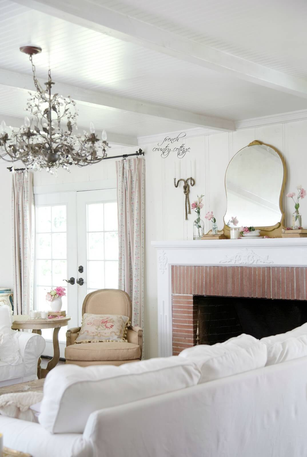 Understated Space with Chandelier and Fireplace