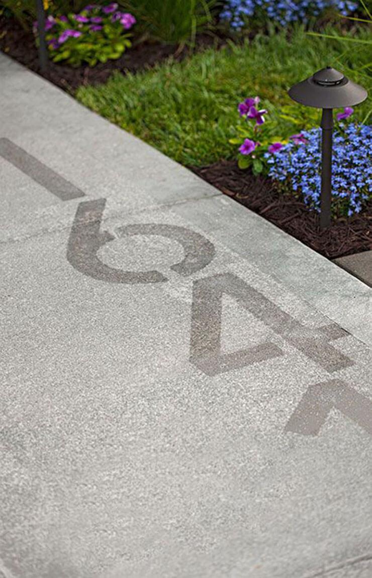 House Number Stenciled onto a Sidewalk