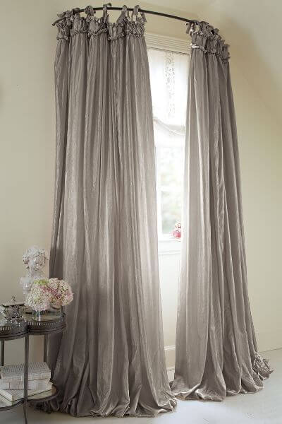 Dramatic Windows with Draped Curtains