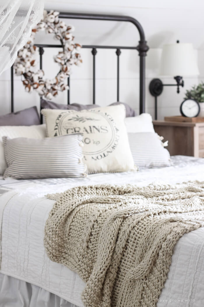 Gable-Style Iron and Linen Bedroom Decor