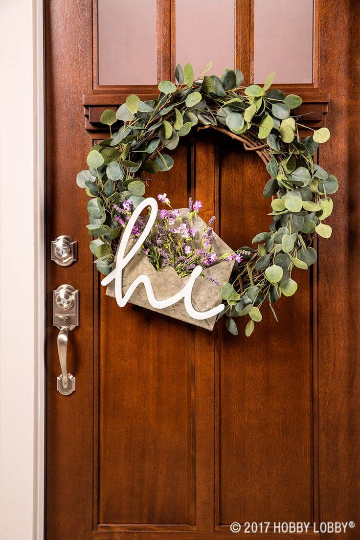 Wreath with Green Leaves and a Decorated Envelope