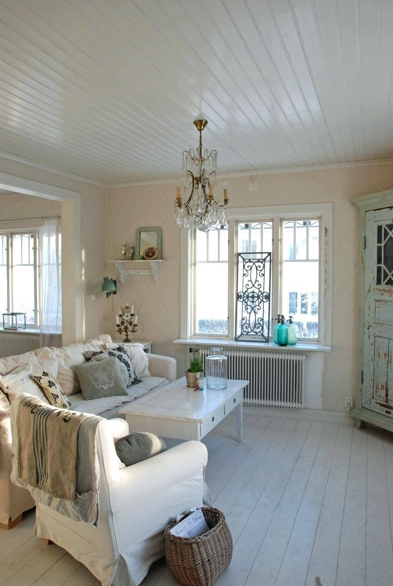 Calming Living Room with Pale Blue Cabinet