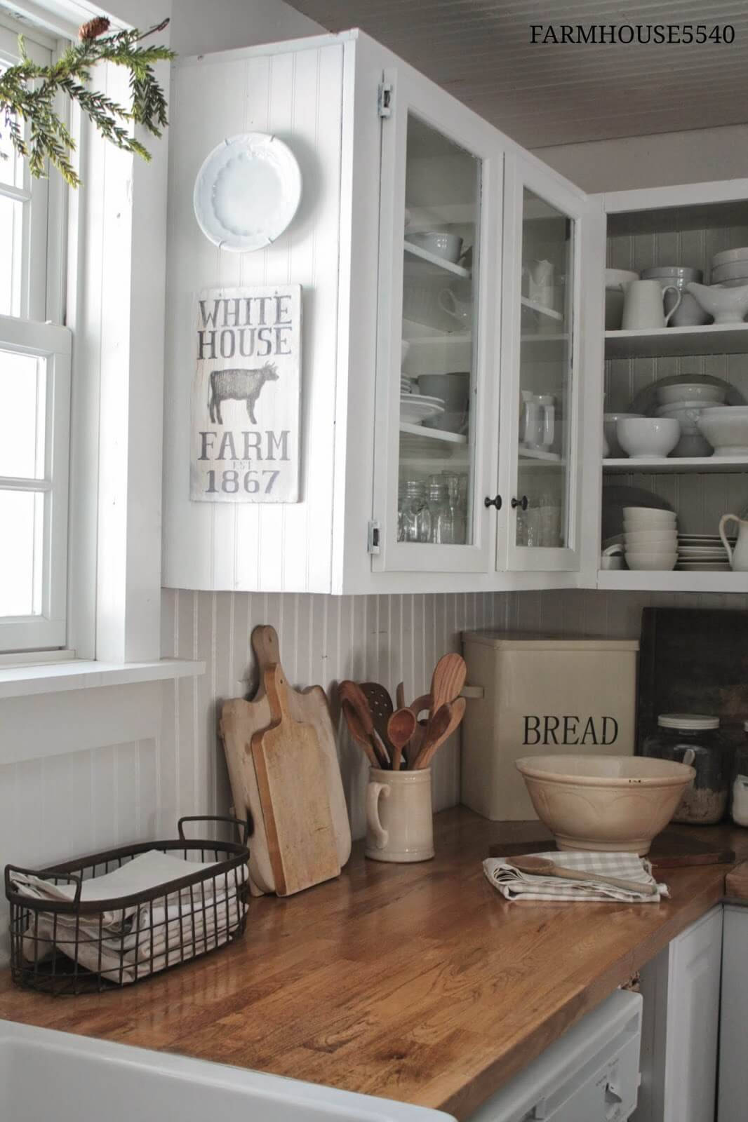White Paneling Open-Face Farmhouse Cabinets