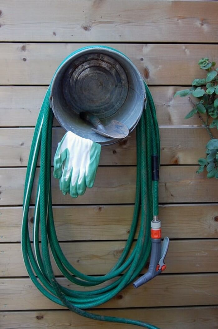 Outside Hose and Gardening Organization Featuring Bucket
