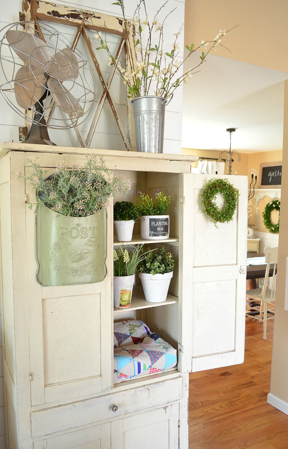 White Planter Arrangements and Moss Wreath