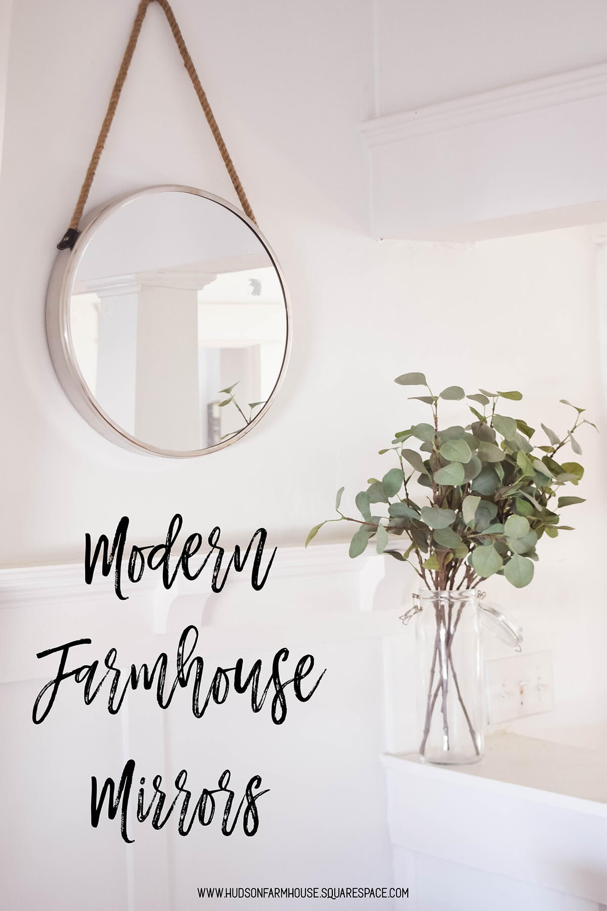 Round Silver Mirror Hanging on the Wall