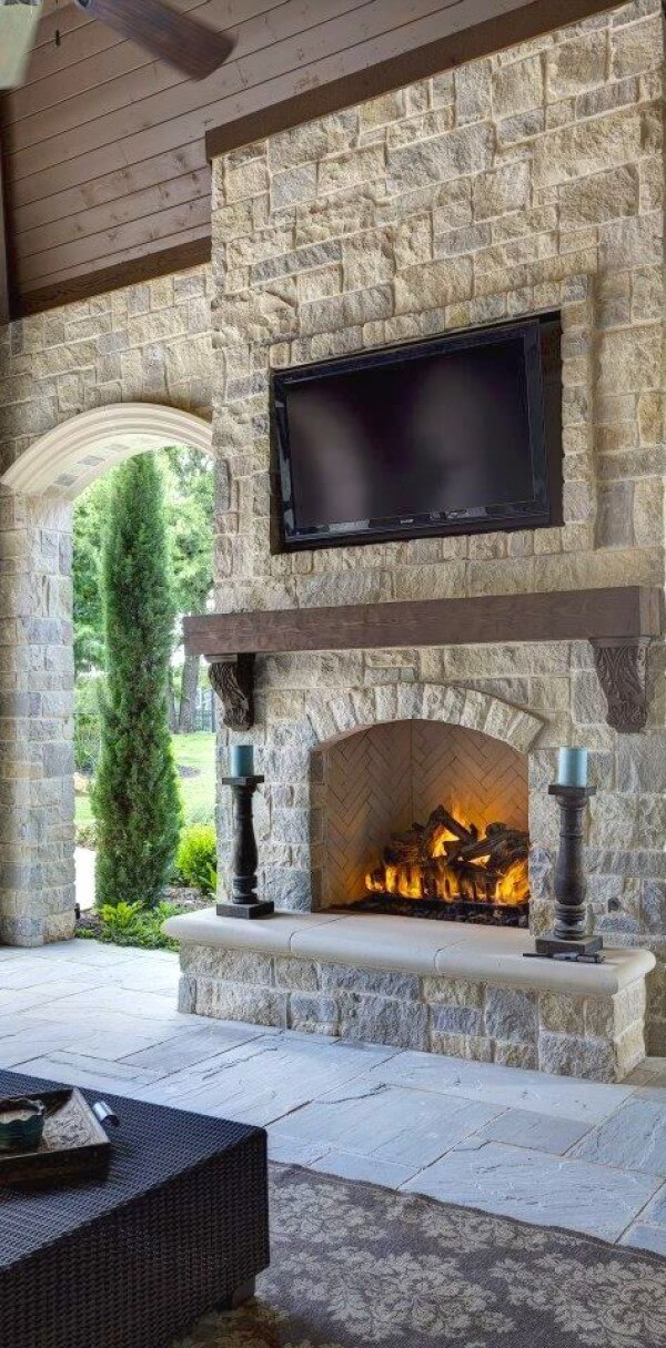 Natural Stone Fireplace Warms Outside Space
