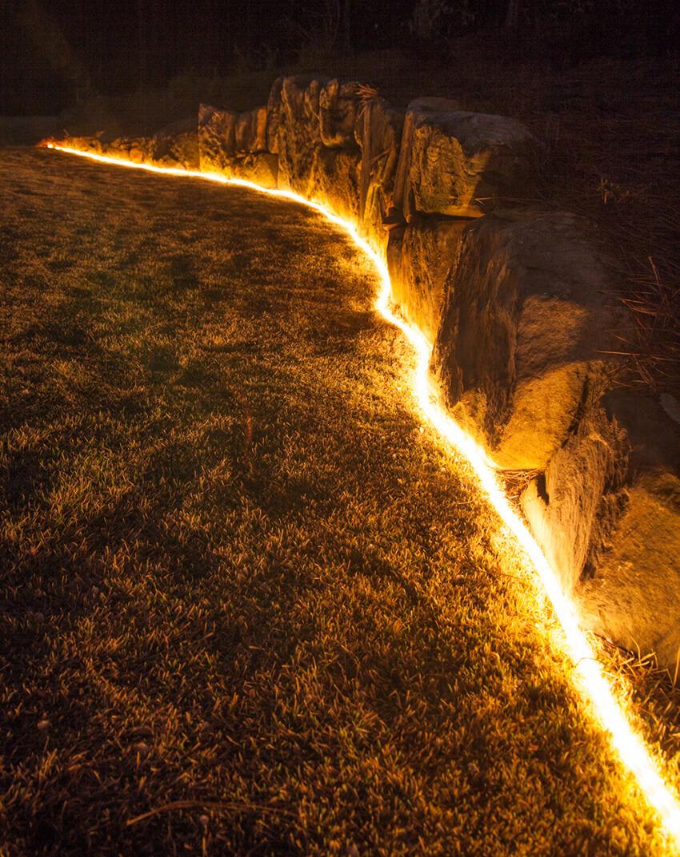 Bright Tube Lighting Along the Rocks