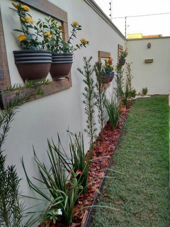 Half Planters Hung in Frames on the Fence