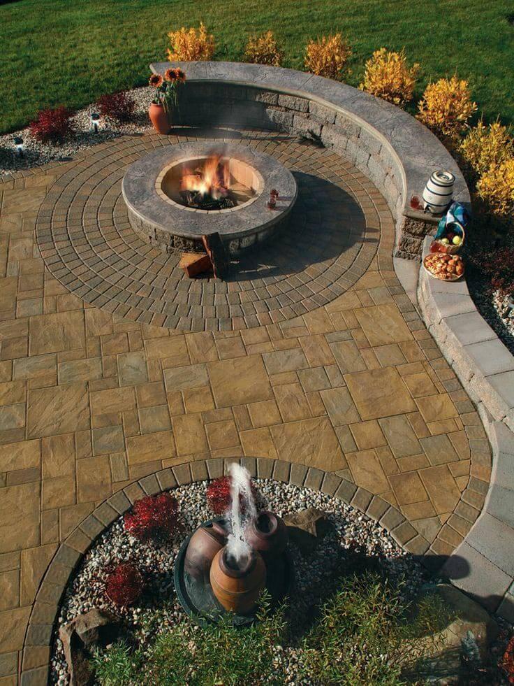 Firepit Alongside a Beautiful Garden Wall