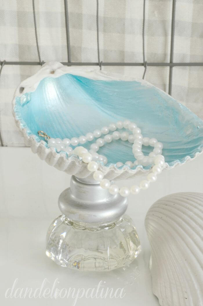 A Blue Clam Shell Jewelry Stand